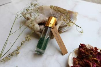 Green Aventurine crystals infused in Geranium Essential Oil.